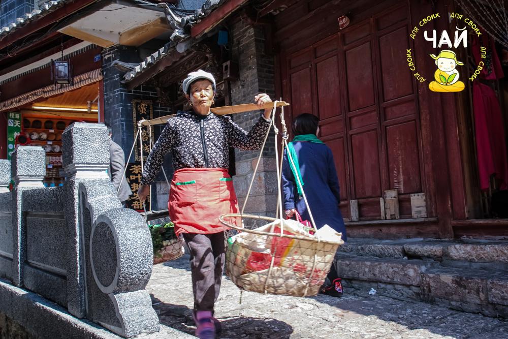 На улицах Лицзяна